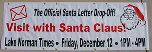 "This banner was created for the Lake Norman Times!.  It is white vinyl with red and back vinyl letters'.  The size is 2' tall and 6'wide.  This banner will be used to promote their ""Official Santa Letter Drop off""."