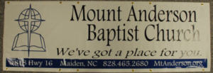 This banner was created for Mount Anderson Baptist Church!.  It is white vinyl with blue and black vinyl letters'.  The size is 2' tall and 6'wide.  We made 4 of these and they plan to use them on a Float in the Christmas Parade.